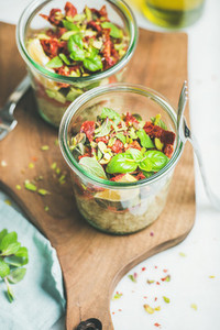 Healthy vegan salad with quionoa  avocado  dried tomatoes  mint