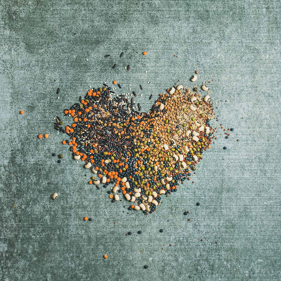 Various raw grains  beans  cereals in shape of heart