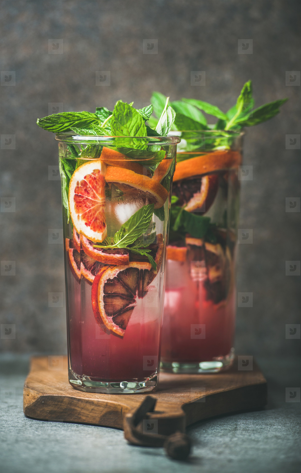 Blood orange citrus lemonade with mint and ice in glasses