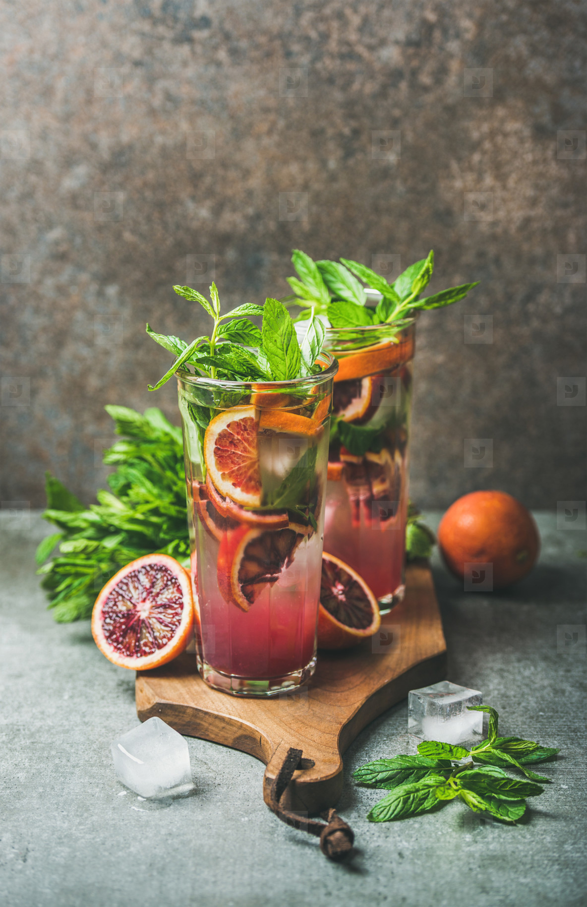 Blood orange citrus lemonade with mint and ice on board