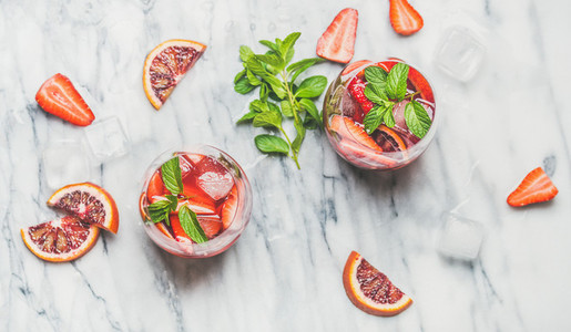 Orange and strawberry summer Sangria with fresh mint leaves