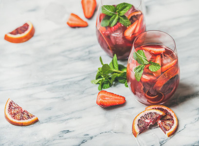 Fruit refreshing Sangria cocktails with ice and mint copy space