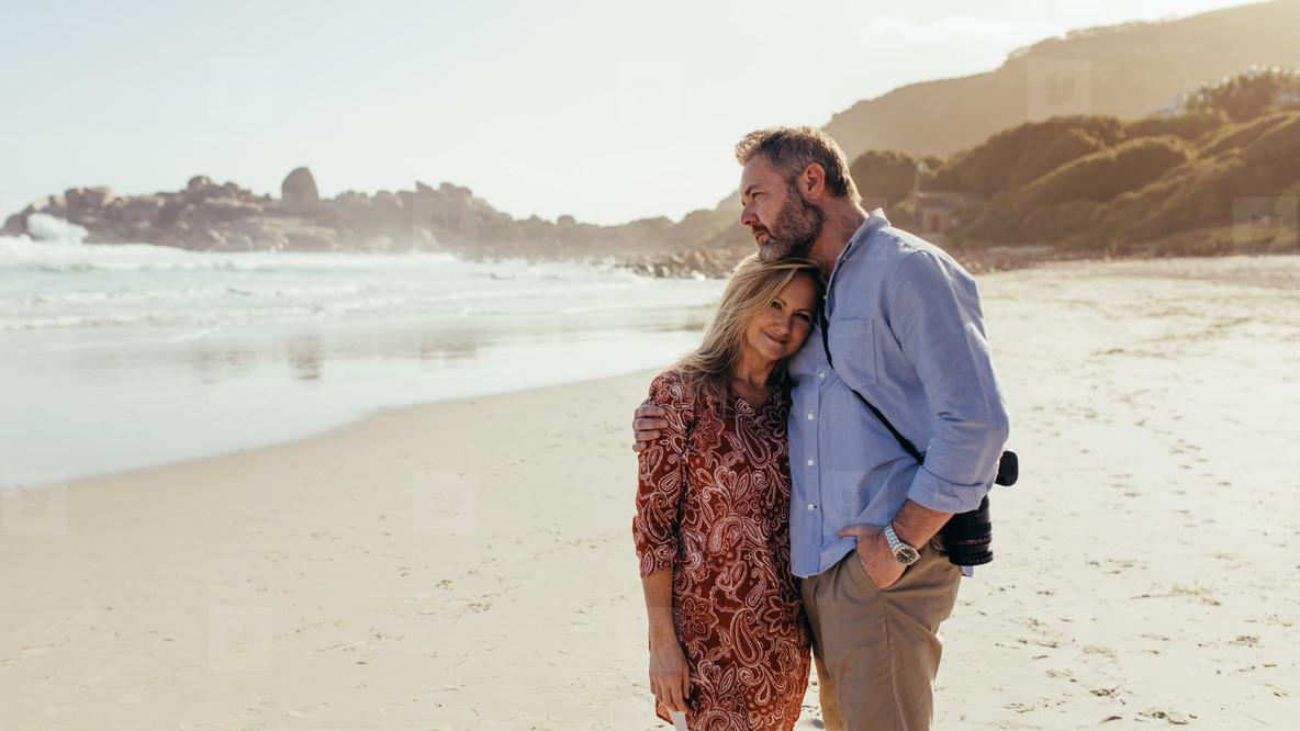 Romantic mature couple on the beach