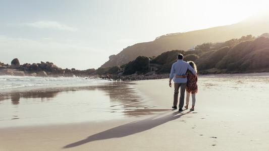 Loving mature couple on a beach walk