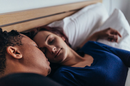 Close up of couple sleeping on bed