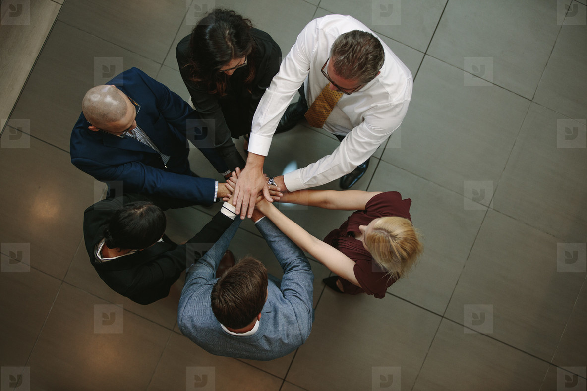 Business team putting hands together