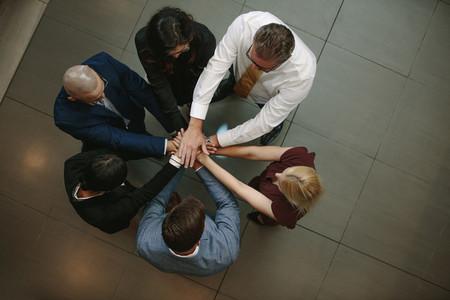 Business team putting hands together
