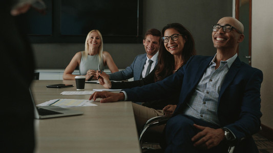 Diverse businesspeople smiling during a meeting