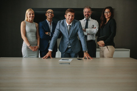 Friendly team of business professionals in boardroom