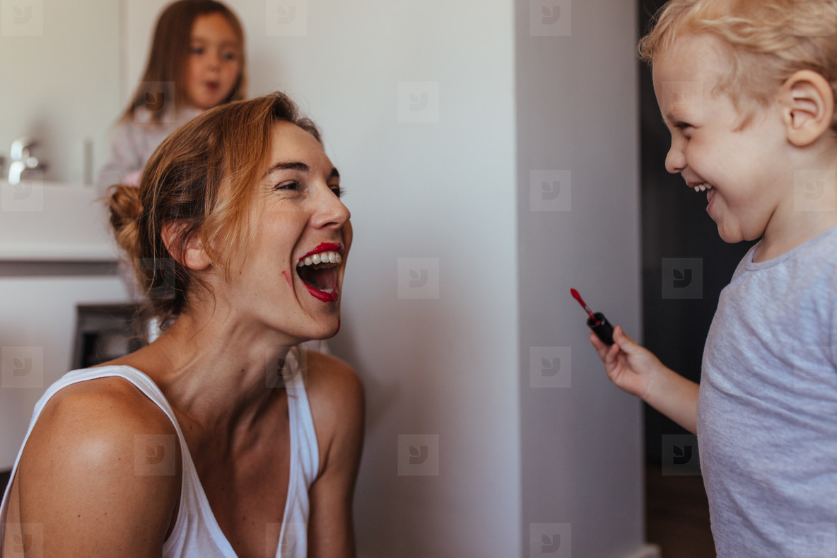 Mother and son playing with makeup