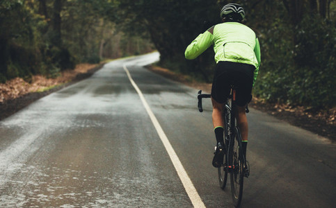 Cyclist practising on a rainy day