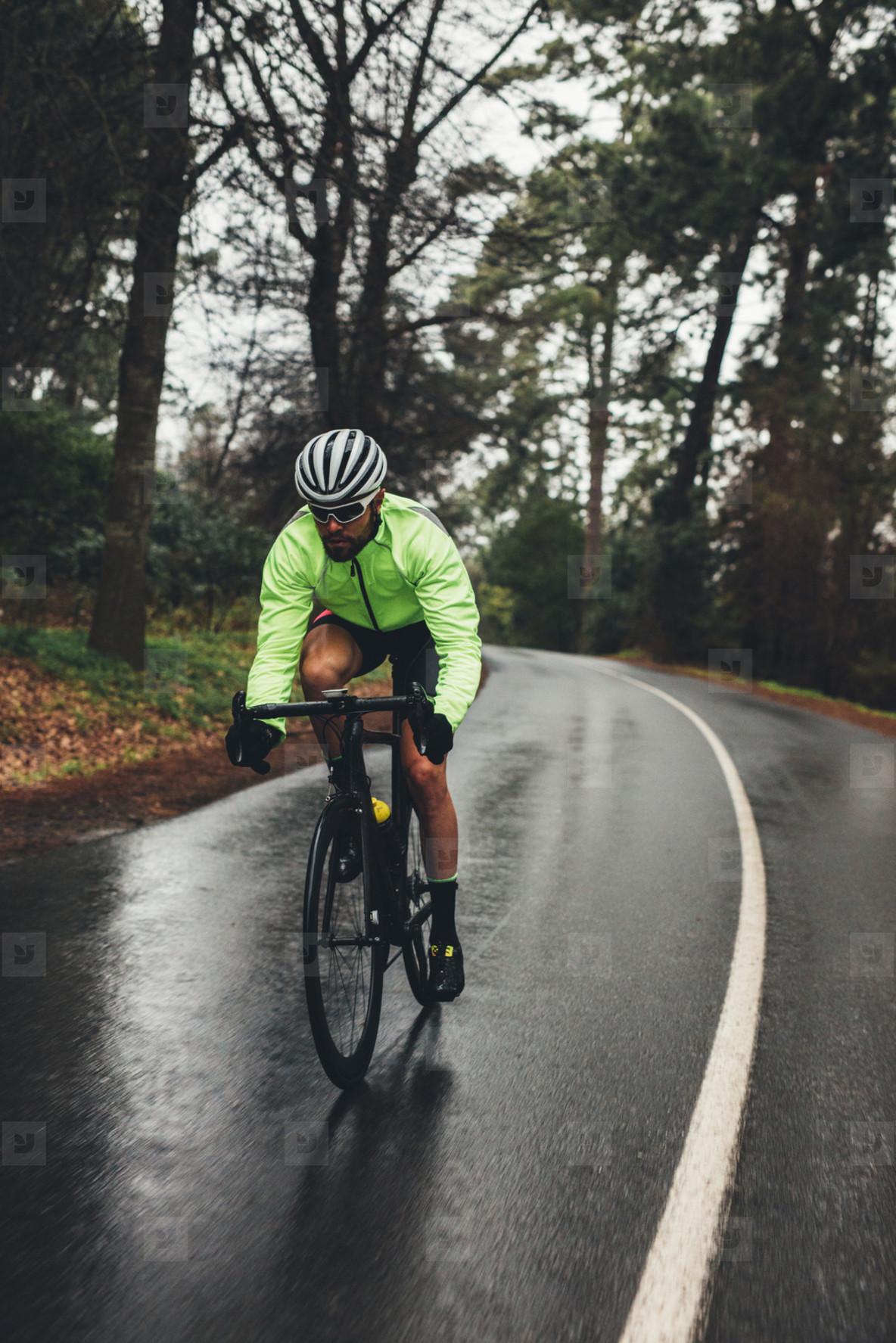 Cyclist training on a rainy day