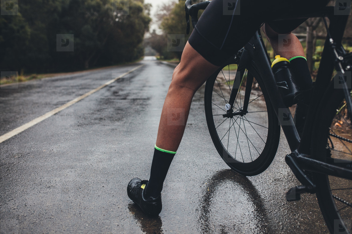 Cyclist training on wet road