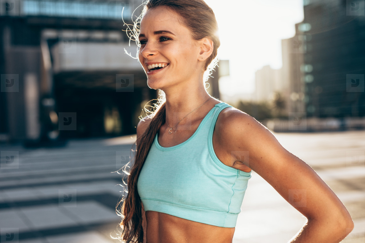 Happy female athlete in morning