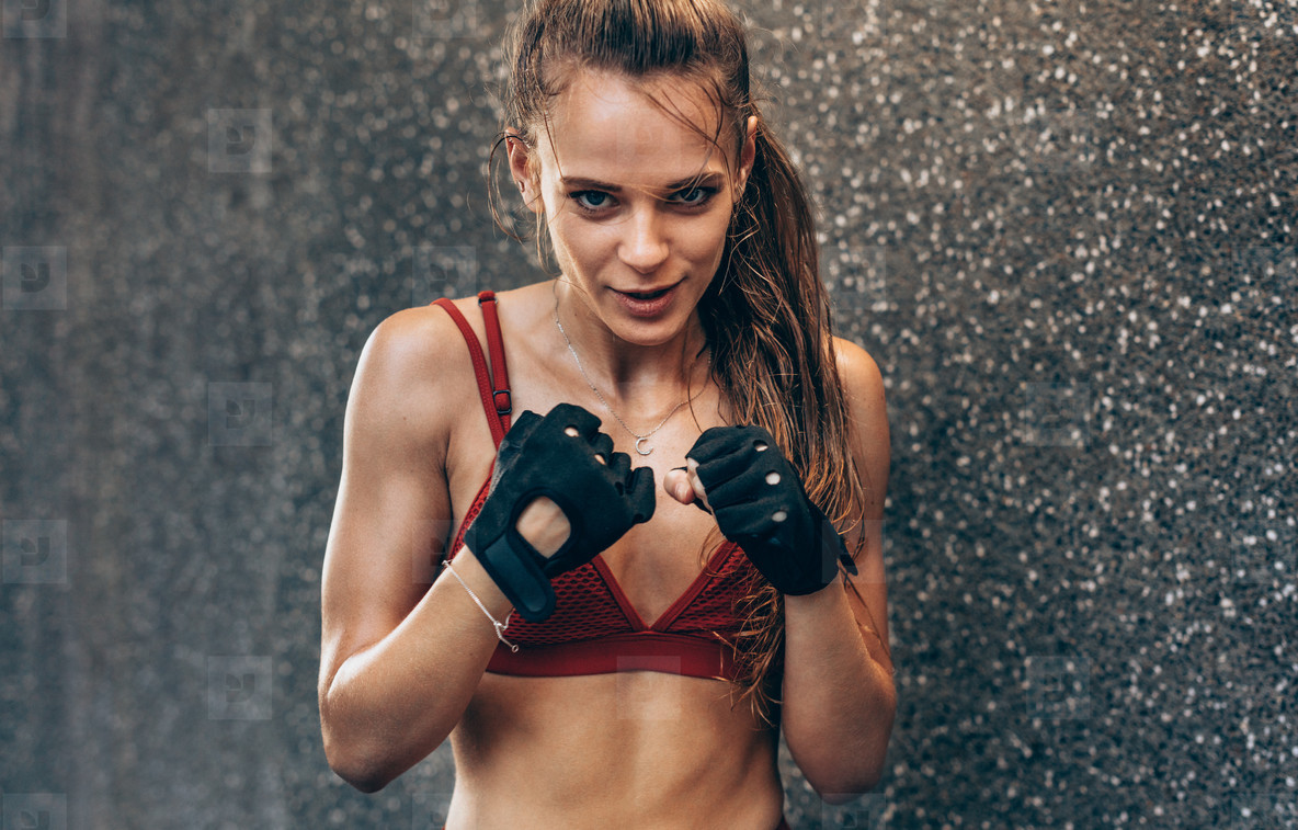 Female wearing gloves ready to fight