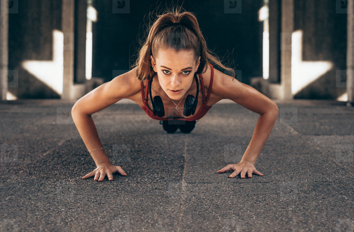 Fit woman doing push ups