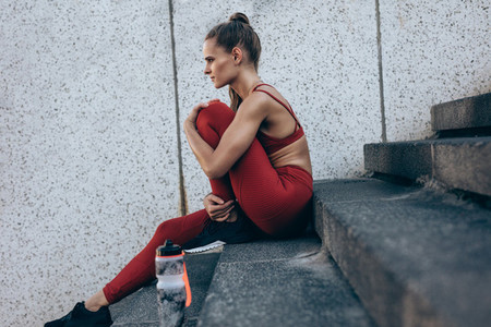 Female runner resting after workout