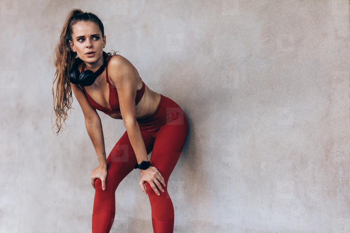 Sportswoman taking break after a run