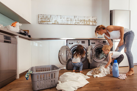 Family doing laundry together at home