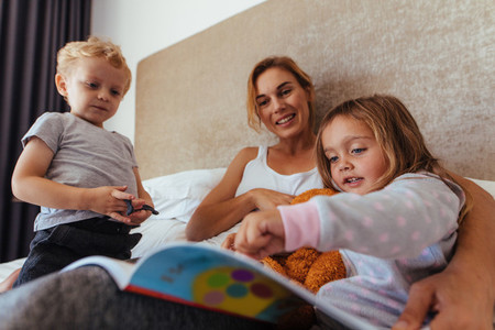 Happy family reading a bedtime storybook
