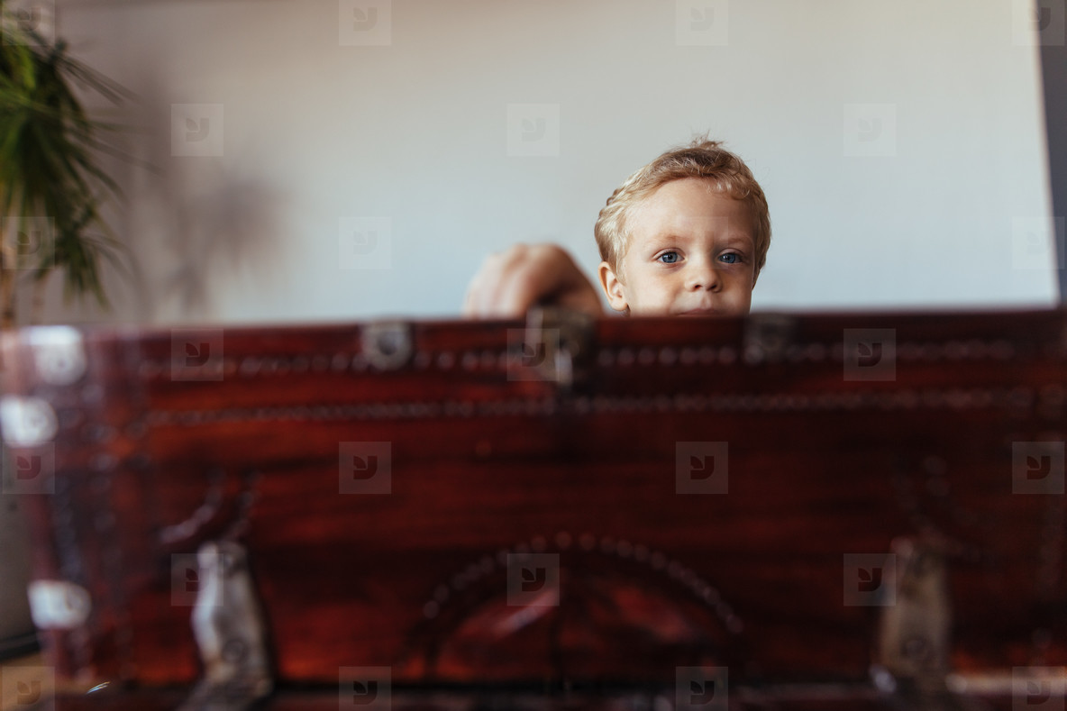 Little boy with an old wooden box