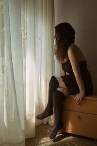 girl sitting on the bedside table