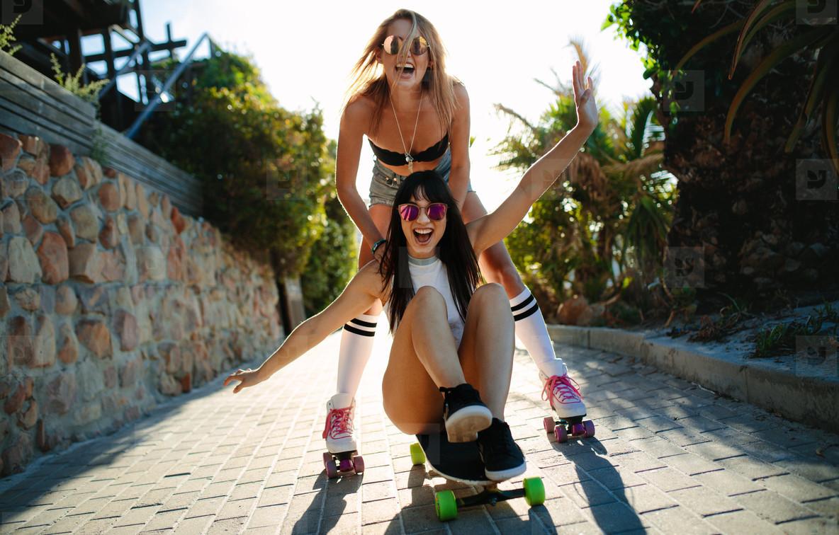 Beautiful girls having fun on a skateboard