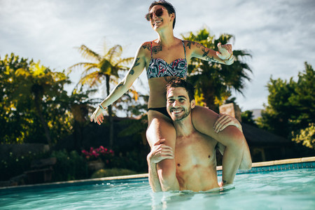 Couple having fun in swimming pool