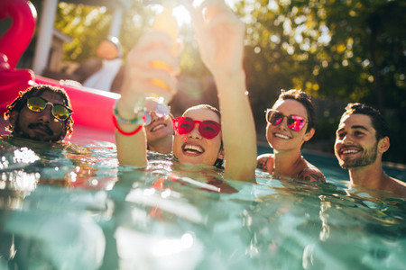 Multiracial group of friends having fun in a pool