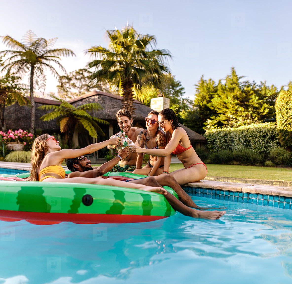 Multi ethnic friends enjoying at pool party