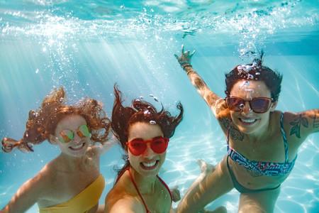 Underwater selfie of smiling females friends in pool