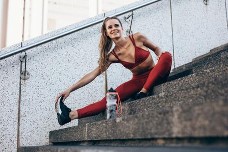 Runner loosening leg muscles after a run