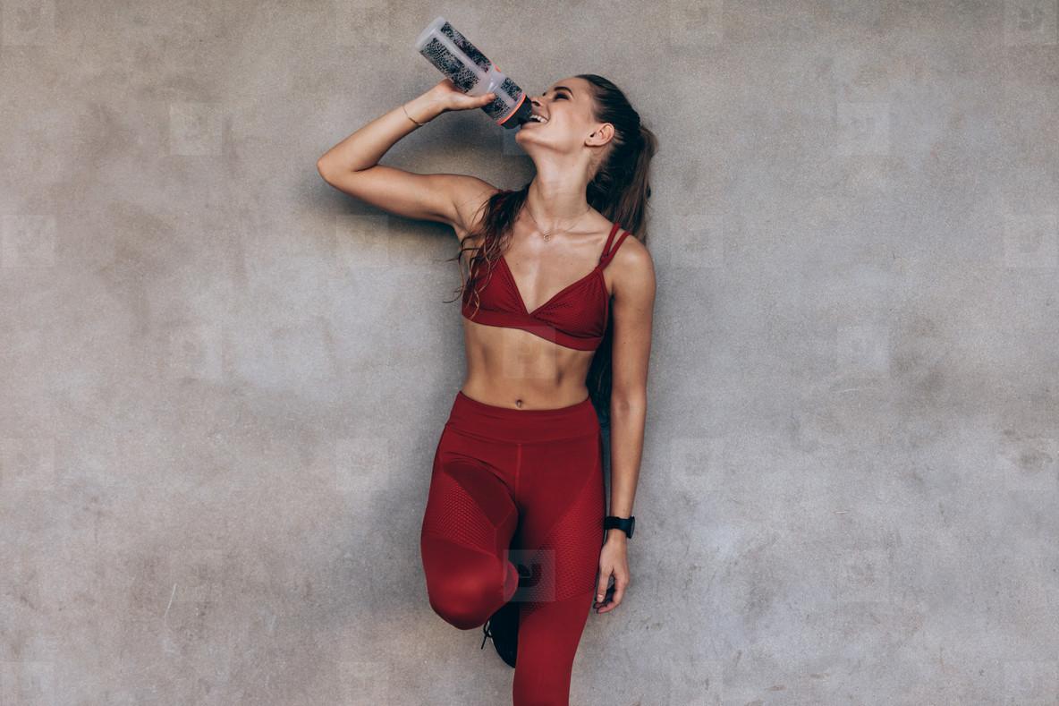 Female athlete drinking water