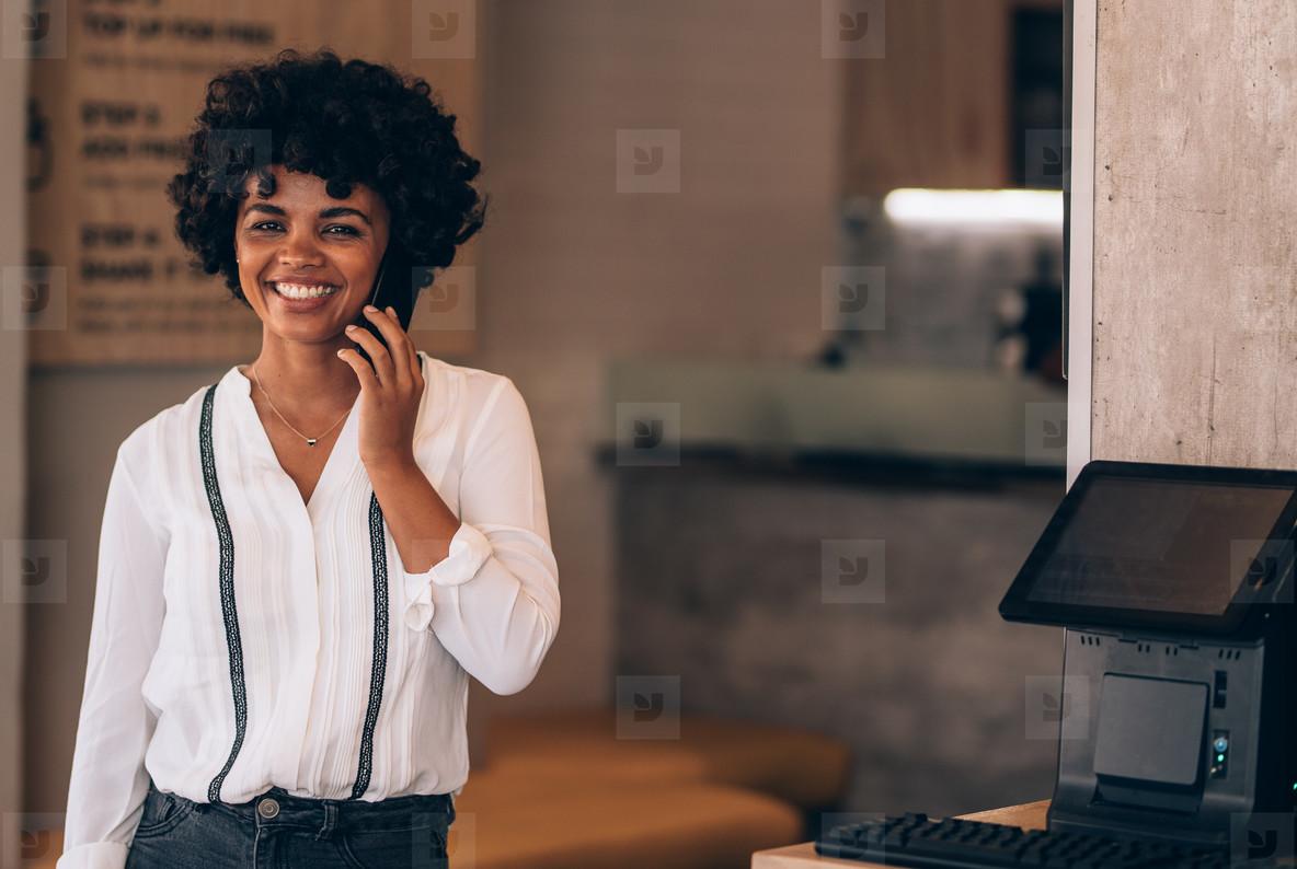 Female restaurant owner talking on phone
