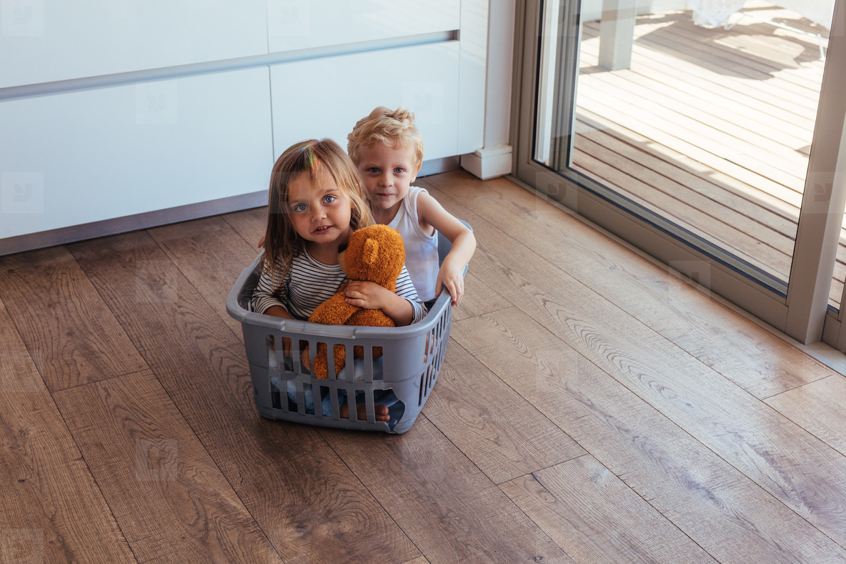 Children sitting in a washing basket