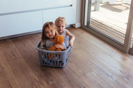 Children sitting in a washing basket
