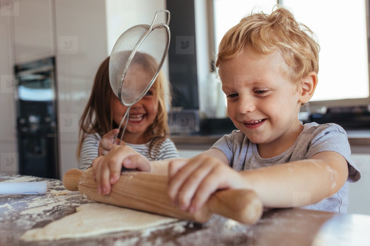 Children making cookies and having fun in the kitchen