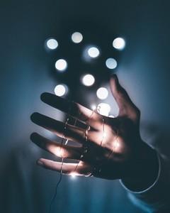 LED light bulb on hand