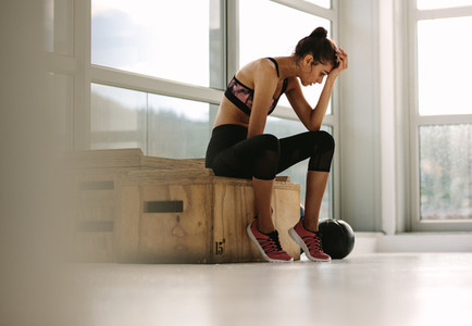 Fitness woman feeling tired after workout