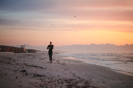 Fit male runner running on the beach