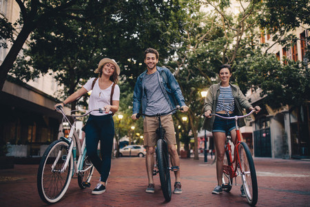 Young people touring the city on bicycles