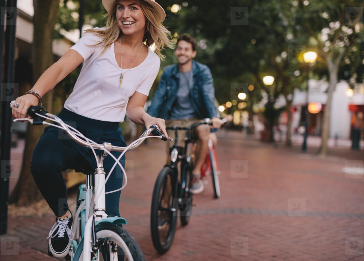 Woman enjoying cycling outdoors with friends