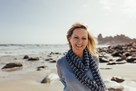 Beautiful senior woman smiling on the beach