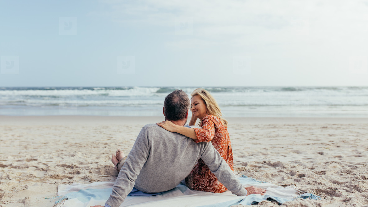 Mature couple spending time on the beach