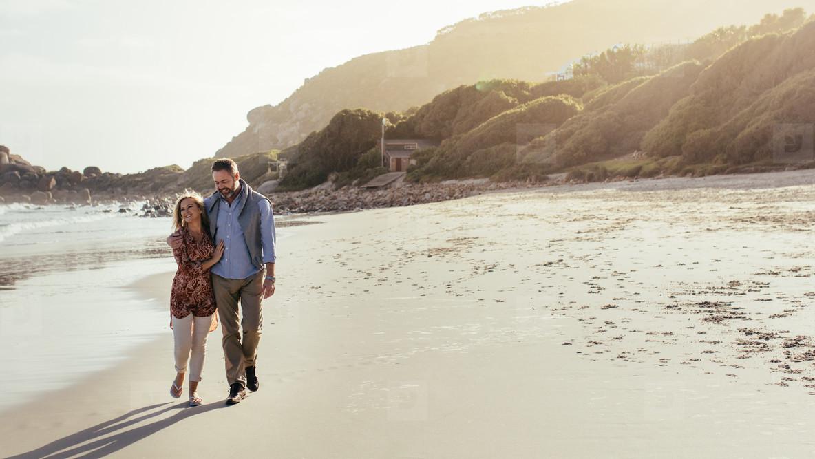 Senior couple strolling on the beach