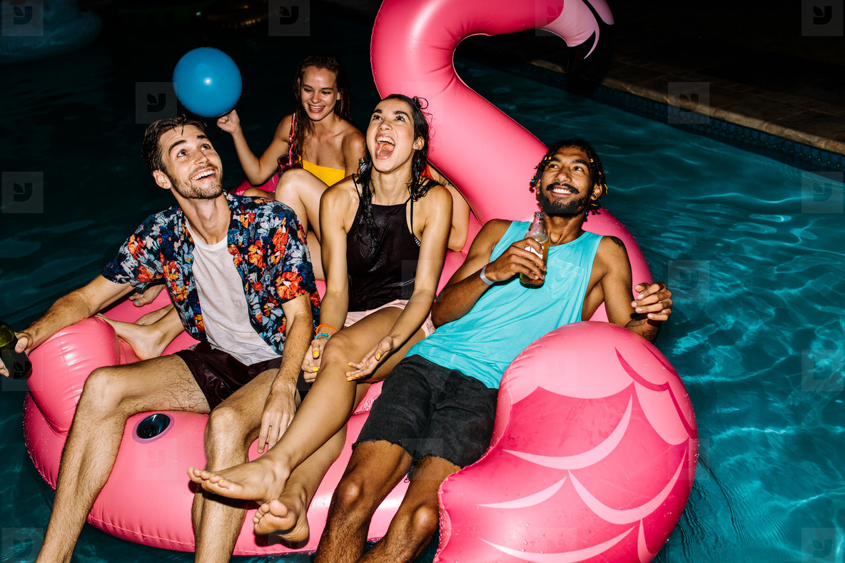 Friends partying in the pool