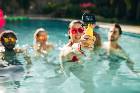 Friends taking selfie at pool party