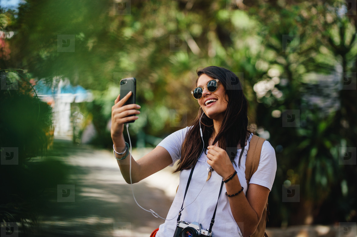 Female traveler taking selfie