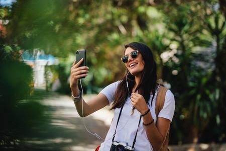 Female traveler taking selfie