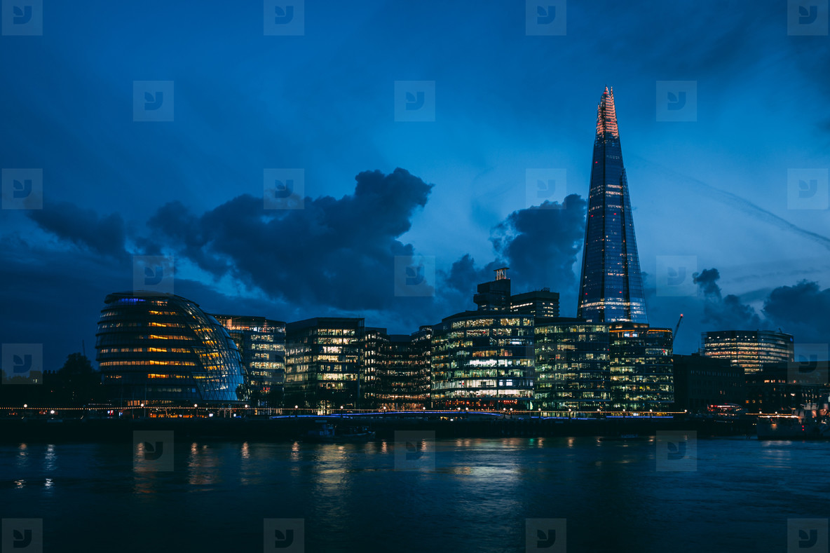 Modern London skyline on River Thames at night